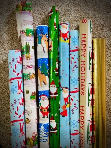rolls of Christmas wrapping paper for Book advent calendar project