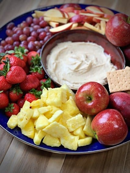 colorful fruit tray and fruit dip that is a kid friendly appetizer for a party