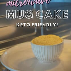 Microwave with door open to reveal a vanilla mug cake just finished baking inside