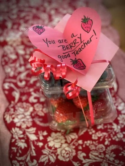 containers of berries with a valentine for teacher attached with ribbon